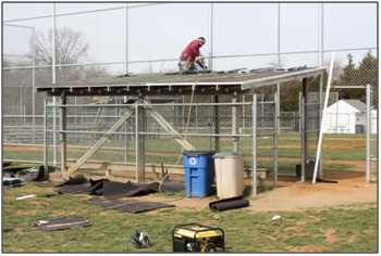 Moss Building & Design working on new roofs for Chantilly Little League