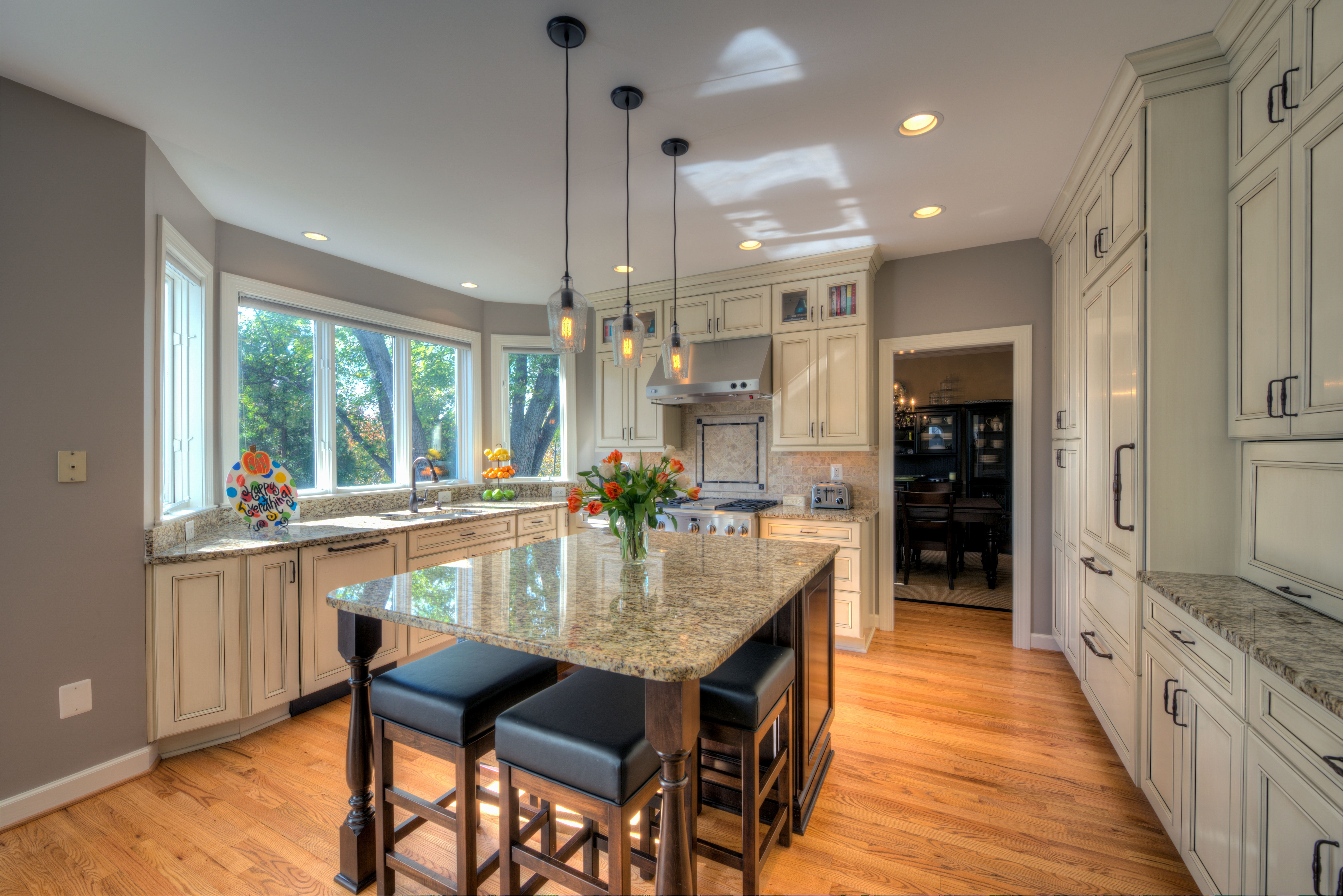 Our fourth example of a transitional kitchen is in herndon virginia the large windows in this kitchen create a space that is well lit with natural light