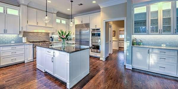Kitchen_Remodel_White_Cabinets_Dark_Hardwood_Moss_Building_Design